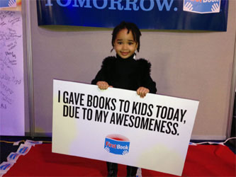 Volunteers Provide New Books to Kids in Need