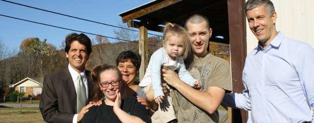 Secretary of Education Arne Duncan (right), joins Save the Children's Senior Vice President Mark Shriver to visit a Whitley County family in Save the Children's Early Steps to School Success program. Also pictured, Save the Children home visitor Martha Paul who works with the family: Holly and Chris and their daughter Lelia, 20 months old.