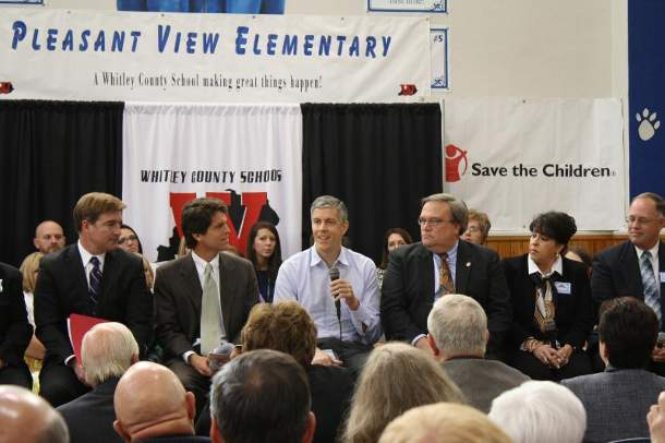 Secretary of Education Arne Duncan (with mic) at an early learning town hall at Pleasant View Elementary School In Williamsburg, KY. He is flanked by Save the Children Senior Vice President Mark Shriver (left) and Senator Robert Stivers (R-25), President of the Kentucky State Senate (right)