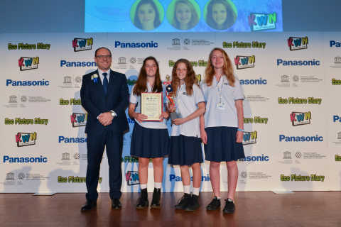 Kid Witness News Grand Prix winning team receiving the trophy from Panasonic France Managing Director, Eric Novel