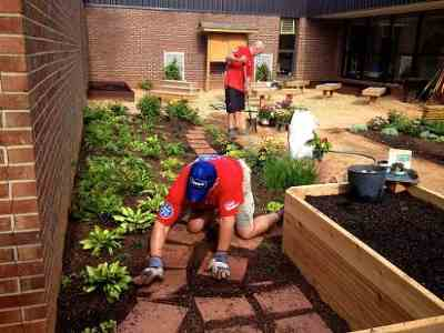 Local Lowe's Heroes employee volunteers often provide hands-on help to complete improvement projects funded by Lowe's Toolbox for Education grants.