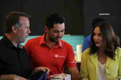 PGA golfer Jason Day with Concur President, Elena Donio, Chief Marketing Officer, Jerame Thurik and Concur employees for the Boys and Girls Clubs of King County