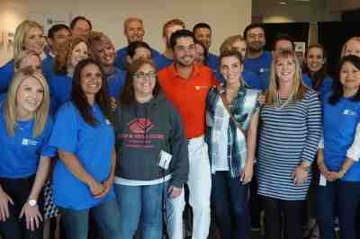 PGA golfer Jason Day and wife Ellie stuff backpacks with Concur employees for the Boys and Girls Clubs of King County