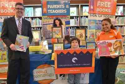 Pictured L to R: Los Angeles student Lucas Verdin (center) joins John F. Szabo, City Librarian, Los Angeles Public Library, and Fabi Harb, Multicultural Marketing Manager, Infinity Insurance in celebrating Read Conmigo's 10,000 book donation to the libraries.