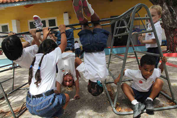 Children play outdoors at a school in Curaçao, the Netherlands. Photo: UNICEF / Roger LeMoyne