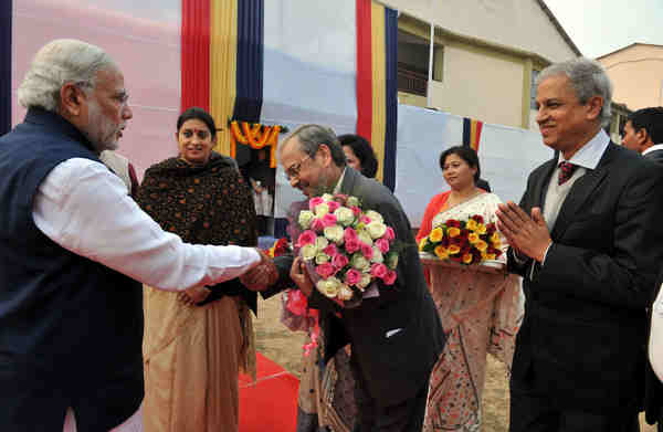 Narendra Modi being welcomed at the foundation stone laying ceremony of new campus of IIIT Guwahati, Assam on January 19, 2016.
