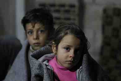 Ghinwa, 7, and her brother Alaa, 11, at Al-Khalidia Al-Khamisa informal settlement in Homs, Syria. January 2016