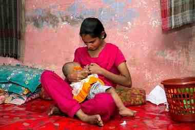 Mother breasfteeding her baby in Bangladesh, 2015. Bangladesh has cut its child mortality rates by roughly half in recent decades.