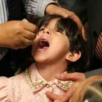 A girl is administered a dose of oral poliovirus vaccine in Sana'a, Yemen