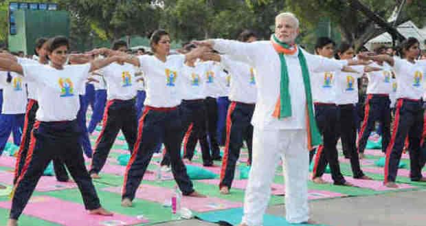 Narendra Modi Playing Yoga Tricks. Photo: Press Information Bureau