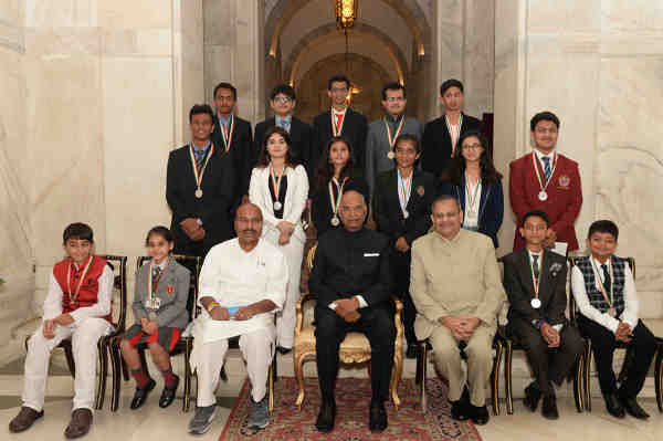 Ram Nath Kovind in a group photograph with the recipients of the National Child Awards for exceptional achievements, on the occasion of Children's Day, at Rashtrapati Bhavan, in New Delhi on November 14, 2017