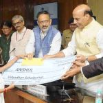 The Union Home Minister, Shri Rajnath Singh distributing the scholarship cheques to the school going children of Central Armed Police Forces (CAPFs) and Assam Rifles (AR) personnel, who sacrificed their lives in the service of the nation, at a function, in New Delhi on August 27, 2018. The Union Home Secretary, Shri Rajiv Gauba is also seen.