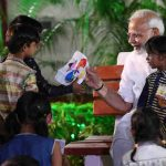 Narendra Modi interacting with the children from poor and underprivileged sections, in Varanasi, Uttar Pradesh on September 17, 2018