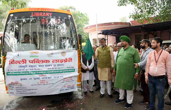 Prahalad Singh Patel flagging off the 'Mobile Library', at a function, at Delhi Public Library, in front of Delhi Railway Station on July 31, 2019. Photo: PIB